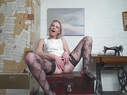 Emaciated granny Artemia in stockings enjoys playing greatest extent home unaccompanied