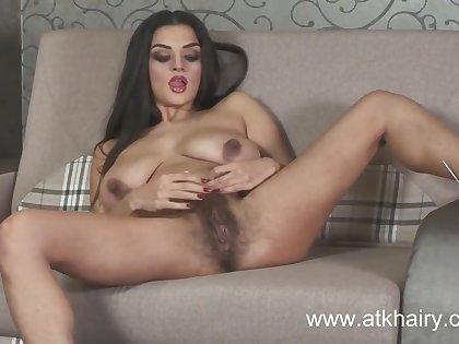 Latoya masturbates her hairy pussy for America