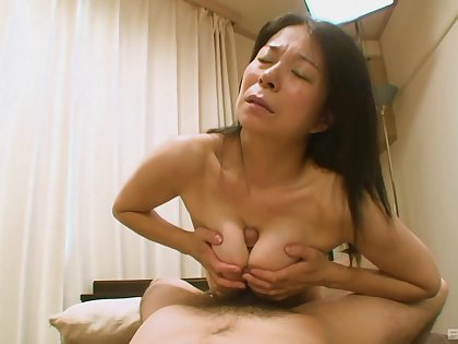 Hairy Japanese grandma Akiko Oda laying on her back having sex